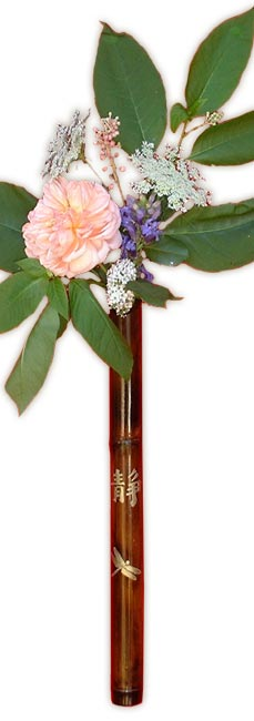 Bamboo wall vase with flowers